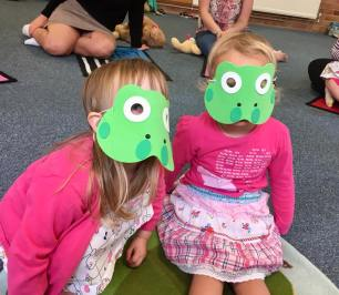 Two little speckled frogs